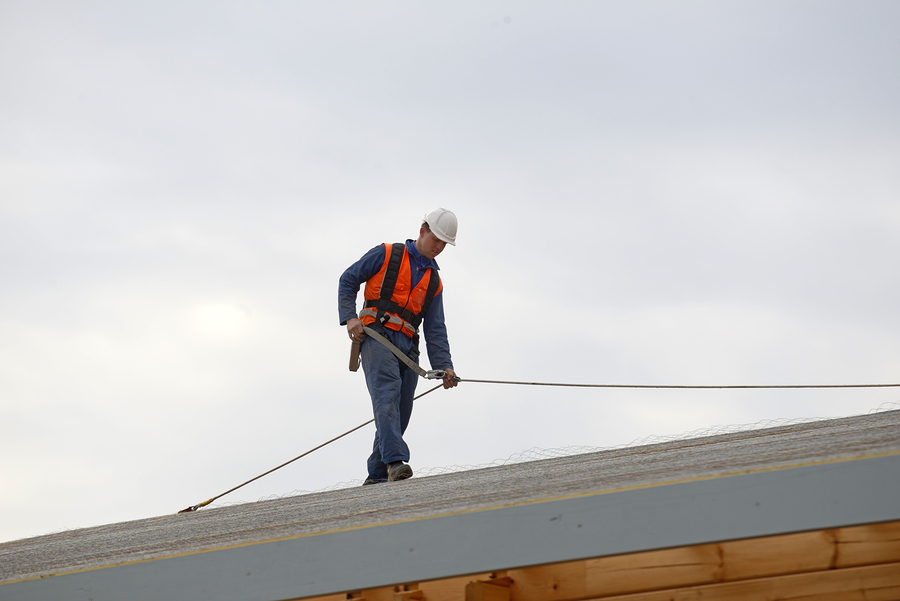 This is a picture of a Roseville roofer pros.